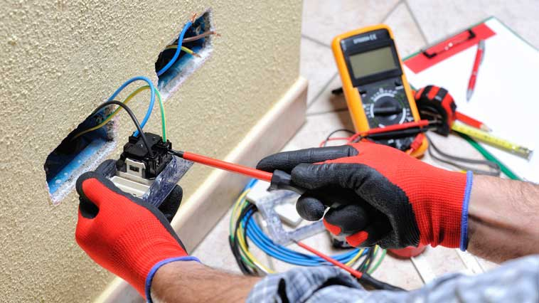 Electrician replaces electrical wiring and equipment using hand tools.