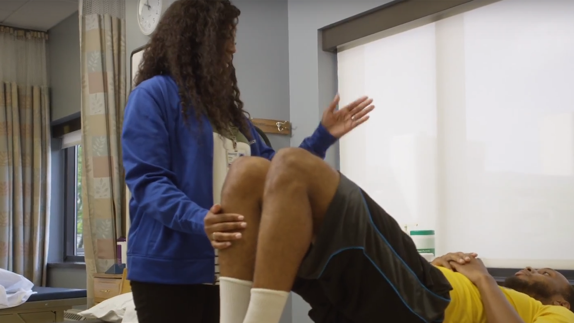 A physical therapist assistant working with a patient.
