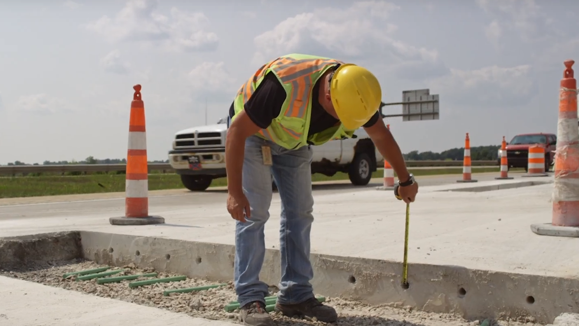 An engineering technician measuring the thickness of concrete.