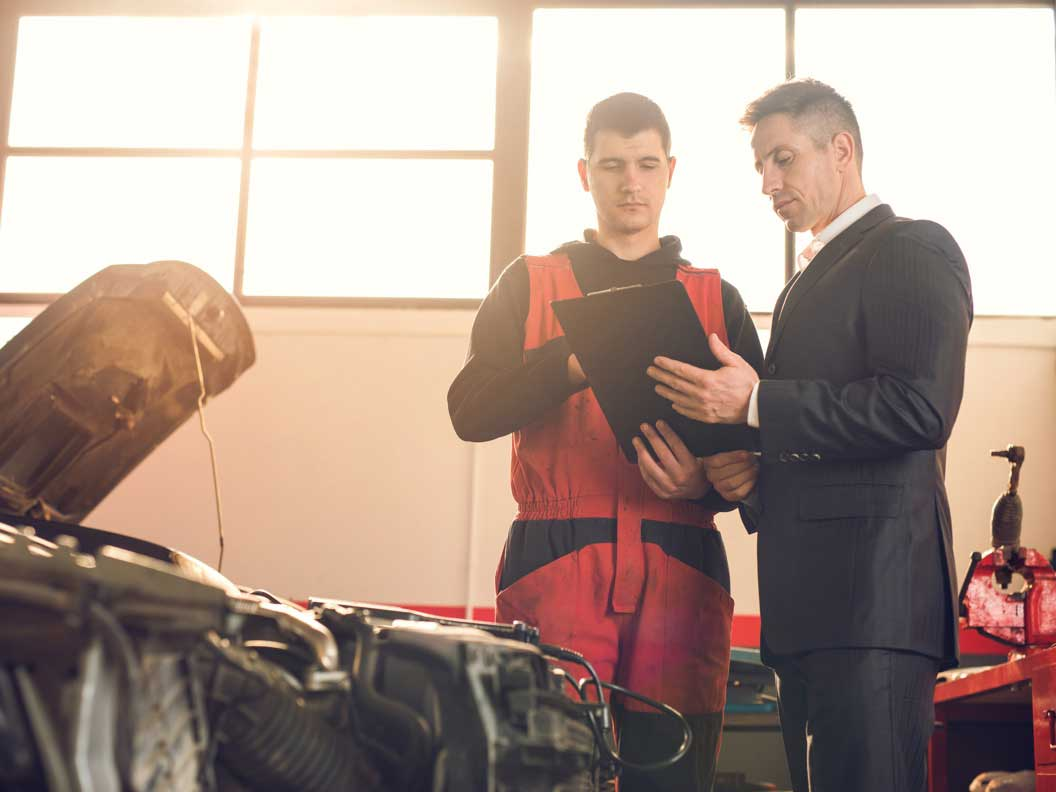 Diesel engine specialist consults with a customer.