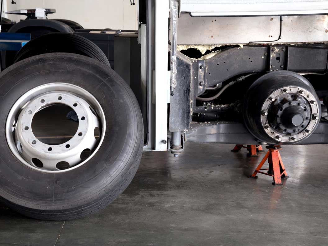 Tire rotation being performed at a bus and truck mechanic shop.