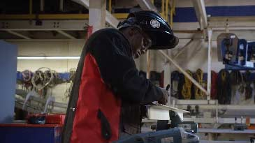 A millwright working in a shop.